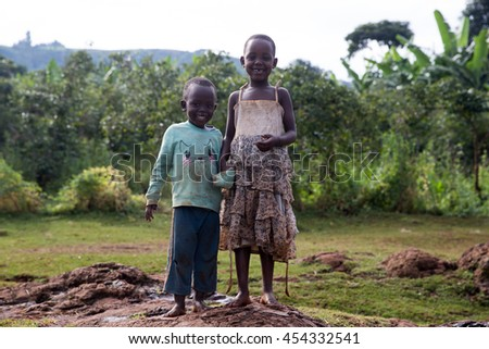 June 22, 2016: Sipi Falls, Uganda. Brother and sister pose for a photo outside their home in the mountains of Sipi Falls, Uganda