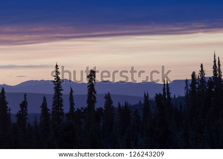 June sunset in the middle of the night in Alaska - stock photo