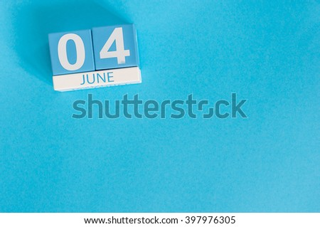 June 4th. Image of june 4 wooden color calendar on blue background.  Summer day, empty space for text - stock photo