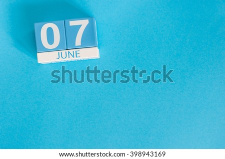 June 7th. Image of june 7 wooden color calendar on blue background. Summer day, empty space for text - stock photo