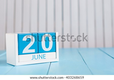 June 20th. Image of june 20 wooden color calendar on white background. Summer day. Empty space for text. Ride to Work Day