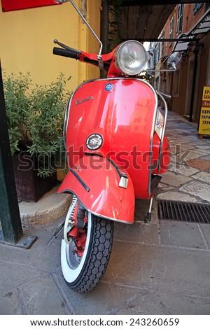 JUNE 26, 2014 - Vespa Scooter at the street of Kerkira (Corfu) City, Corfu Island, Greece - stock photo