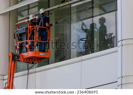 June 7, 2014: window washers cleaning exterior glass on a building in Houston, Texas - stock photo