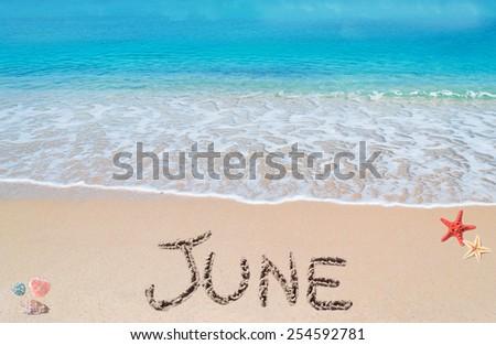 june written on a tropical beach - stock photo