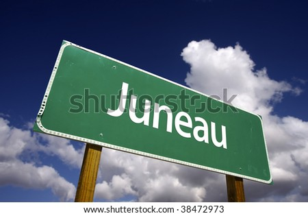Juneau Road Sign with dramatic blue sky and clouds - U.S. State Capitals Series. - stock photo