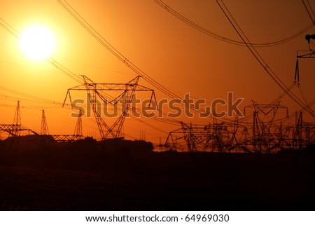 jungle of high voltage transmission towers - stock photo