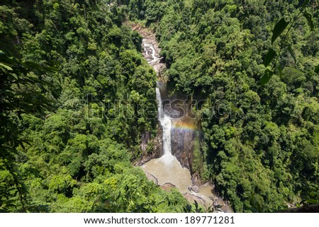 Jungle waterfall with rainbow in rural Thailand - stock photo