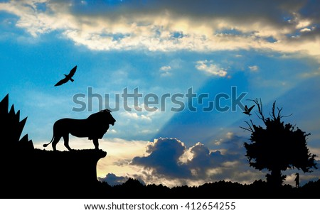 Jungle with mountains, old tree, birds lion and meerkat on blue cloudy sunset background - stock photo