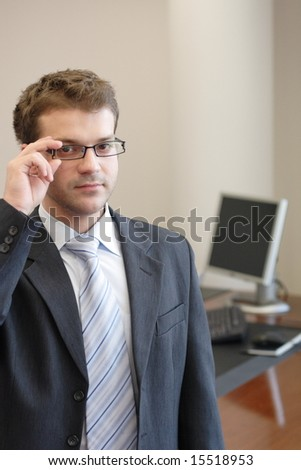 Junior executive in his office portrait - close up - stock photo