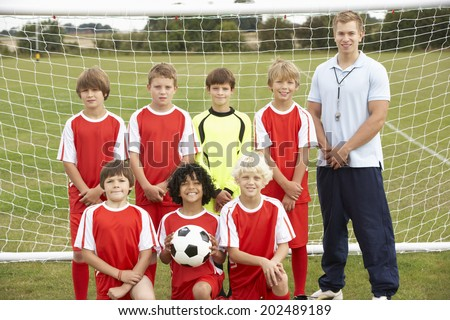 Junior soccer team and coach portrait - stock photo
