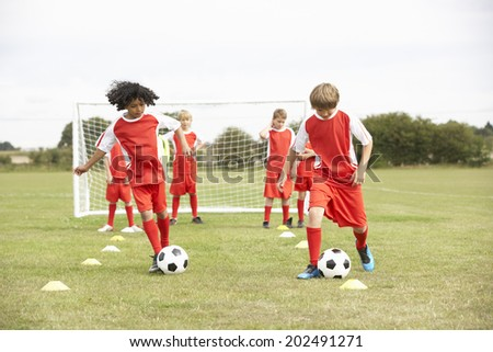 Junior soccer team in training - stock photo