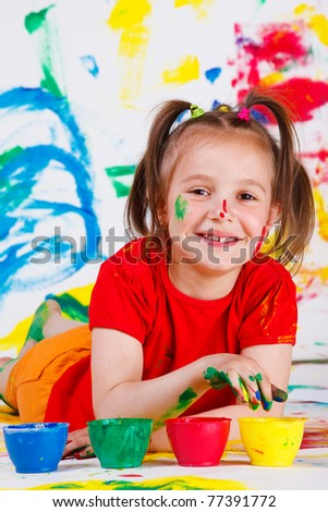 Junior student drawing with her fingers - stock photo