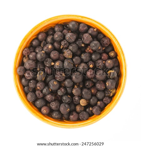 Juniper berries in bowl isolated on white background. - stock photo