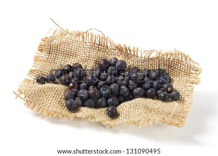 Juniper Berries On Burlap - stock photo