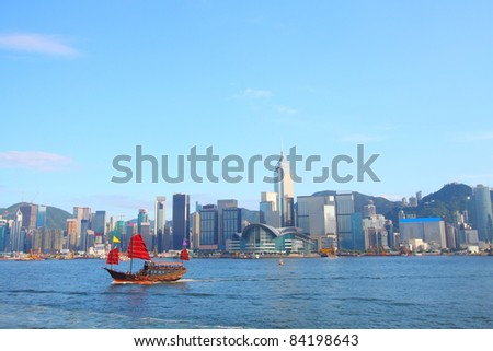 Junk boat in Hong Kong at Victoria Harbour - stock photo