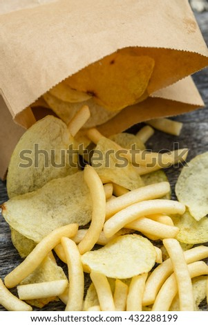 Junk food concept with Crisps and French fries - stock photo