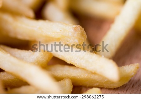 junk-food, fast food and eating concept - close up of french fries on table - stock photo