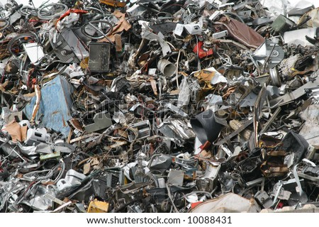 junk yard with old plastic and scrap metal - stock photo