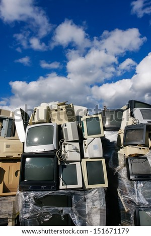Junked crts computer monitors, tvs and old printers for recycling or safe disposal recycling, any logos and brand names have been removed. Great for recycle and environmental themes. - stock photo