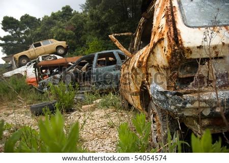 junkyard full of rusty wrecks - stock photo