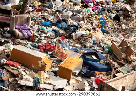 Junkyard of domestic garbage in landfill - stock photo