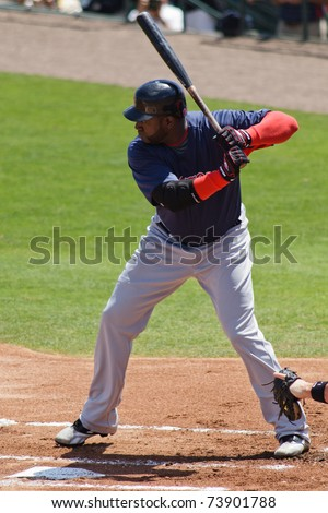 "JUPITER, FL USA - MAR. 24: Red Sox designated hitter David ""Big Papi"" Ortiz bats during the Boston Red Sox vs. Florida Marlins spring training game on March 24, 2010 in Jupiter, FL. - stock photo"