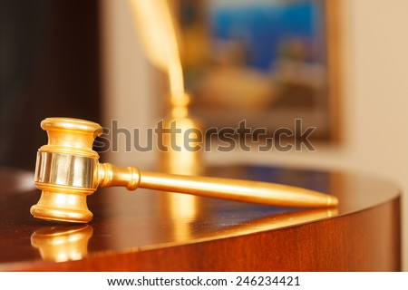 Juridical concept with hammer and pen , selective focus on metal part - stock photo
