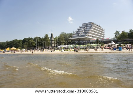 Jurmala, Latvia - August 15, 2015: Rest in the resort of world value. Beach and five-stars Baltic Beach Hotel on the bank of the Gulf of Riga of the Baltic Sea.