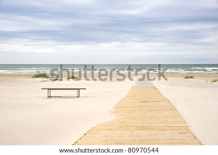 Jurmala (Latvia). The Outlet to the sea between sandy dunes. - stock photo