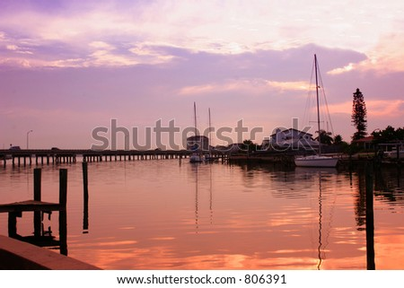 Just after sunrise on Boca Ciega Bay,Pass-a-grill Florida - stock photo