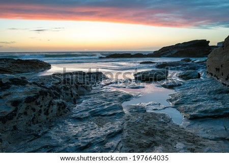 Just after sunset at Trebarwith strand a rocky beach in north Cornwall