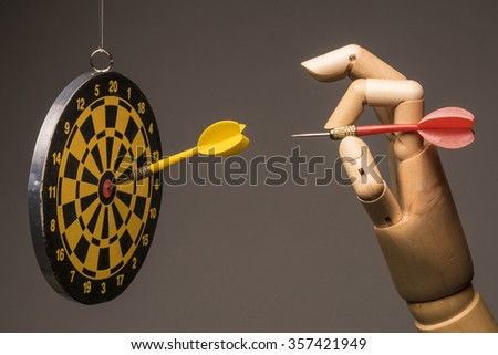 Just aim the target and darts, the marketing metaphor. On grey background. - stock photo