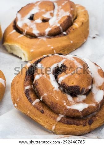 Just baked cinnamon and raisin rolls. - stock photo