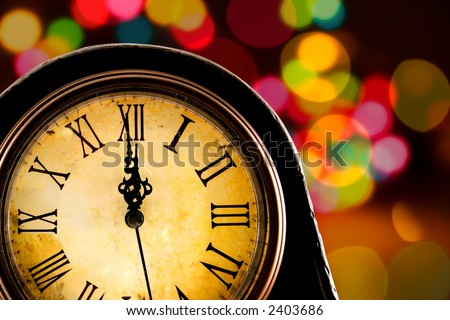 Just before midnight,antique clock with lights in the background