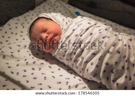 Just born baby boy at ICU in hospital. - stock photo