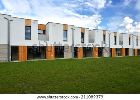 Just built new modern family terraced house surrounded by grassy front gardens