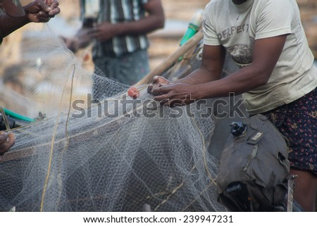 just caught a lot of fish in a boat - stock photo