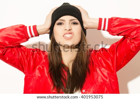 Just dont care. Studio portrait of a beautiful girl making faces isolated on white. - stock photo