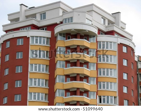 Just finished new luxury apartment house over sky background - stock photo