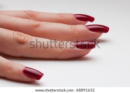 Just from fingernail service - newly painted nails with red enamel - stock photo