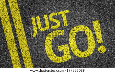 Just Go written on the road - stock photo