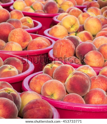 Just harvested peaches at farm market, - stock photo