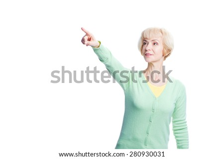Just look at this! Advertising your product. Amazed middle aged woman looking and pointing away. Isolated on white. - stock photo