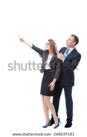 Just look at this! Advertising your product. Full length of happy young couple businessman and businesswoman pointing copy space and smiling while standing isolated on white - stock photo