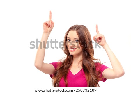 Just look at this! Happy young smiling caucasian woman pointing up copy space while standing isolated on white - stock photo