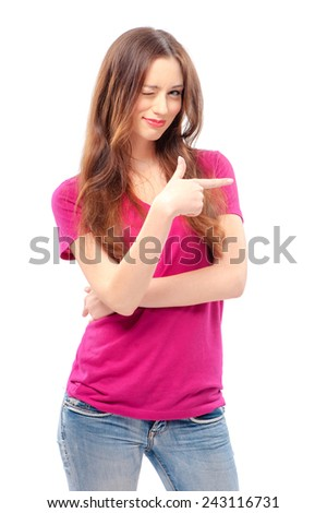 Just look at this! Happy young smiling woman pointing copy space while standing isolated on white - stock photo