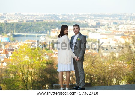 just  married  against the background of Prague - stock photo