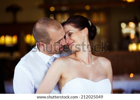 Just married couple embrace, wedding pair hugging, Bride and Groom, Romantic Married Couple in restaurant, holding hands, beautiful couple in the hotel , They Hug each other, wedding - stock photo