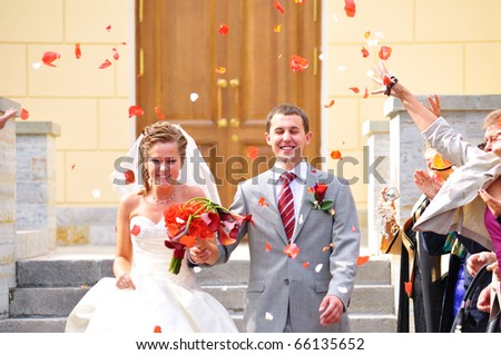 just married couple is being cogratulating by their guests - stock photo