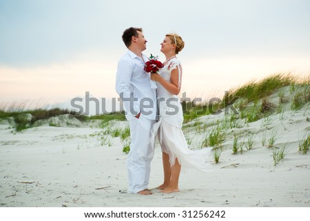 Just married couple looking happily at each other - stock photo